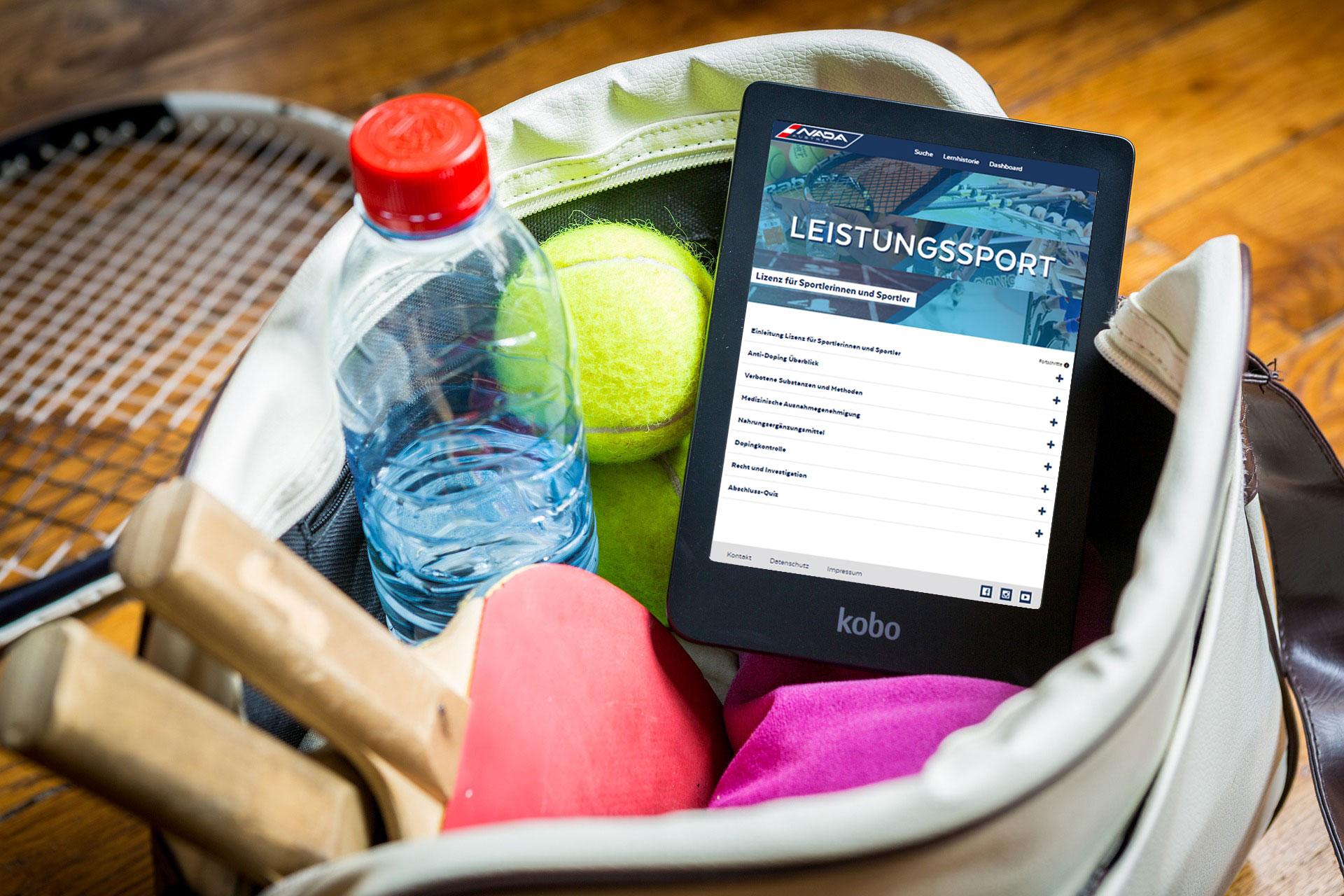 Bild zeigt Beutel mit Sport-Accessoires und Tablet